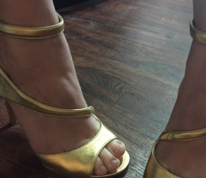 The Nine West Festivitie Evening Sandal in Gold